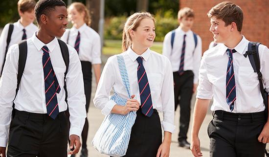 Image of secondary school children in uniform walking