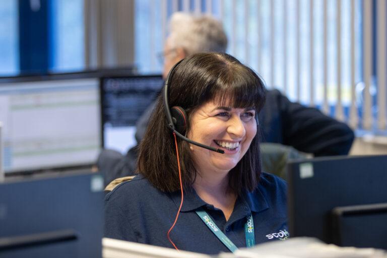 Scomis staff member taking a customer call